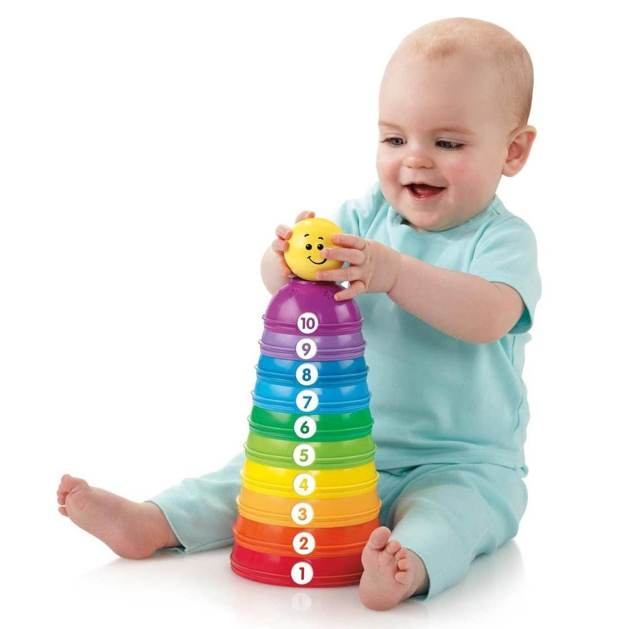 Photo of a baby stacking cups.