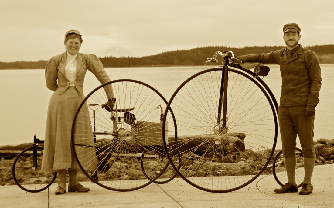 Photo of couple with high wheel bicycles