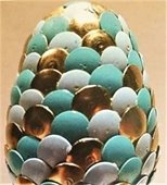 Photo of a 'dragon's egg' made with colorful tacks