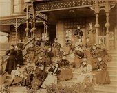 Sepia-toned photo of Everett Woman's Book Club members seated on the steps of the Monte Cristo Hotel