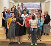 Group photo of staff with Representative Larsen and Librarian of Congress Carla Hayden