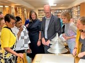Photo of Mayor Cassie Franklin, Librarian of Congress Carla Hayden, Library Director Abby Cooley,  Representative Rick Larsen, and others look at archives in the Northwest Room