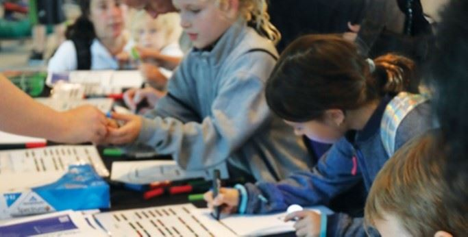 Photograph of children coding using Ozobot Bits