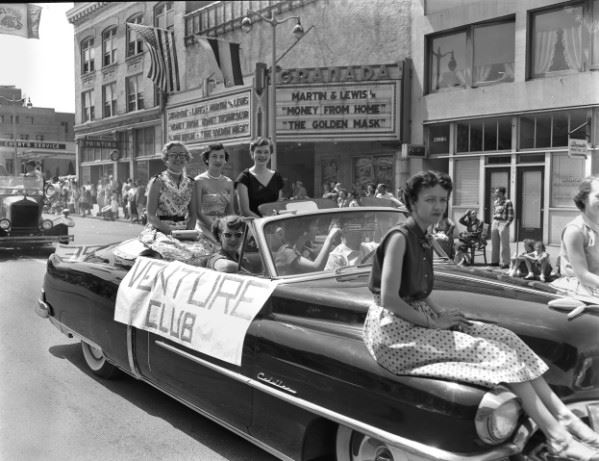 Jim Leo&#39s 1954 black and white photograph of women in venture club convertible during 4th of July