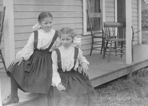black and white photo of 2 young girls on a porch circa 1892