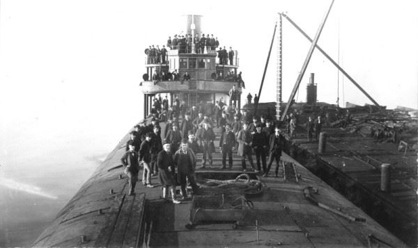 black and white photo of citizens abord the whaleback barge C. W. Wetmore February 1892