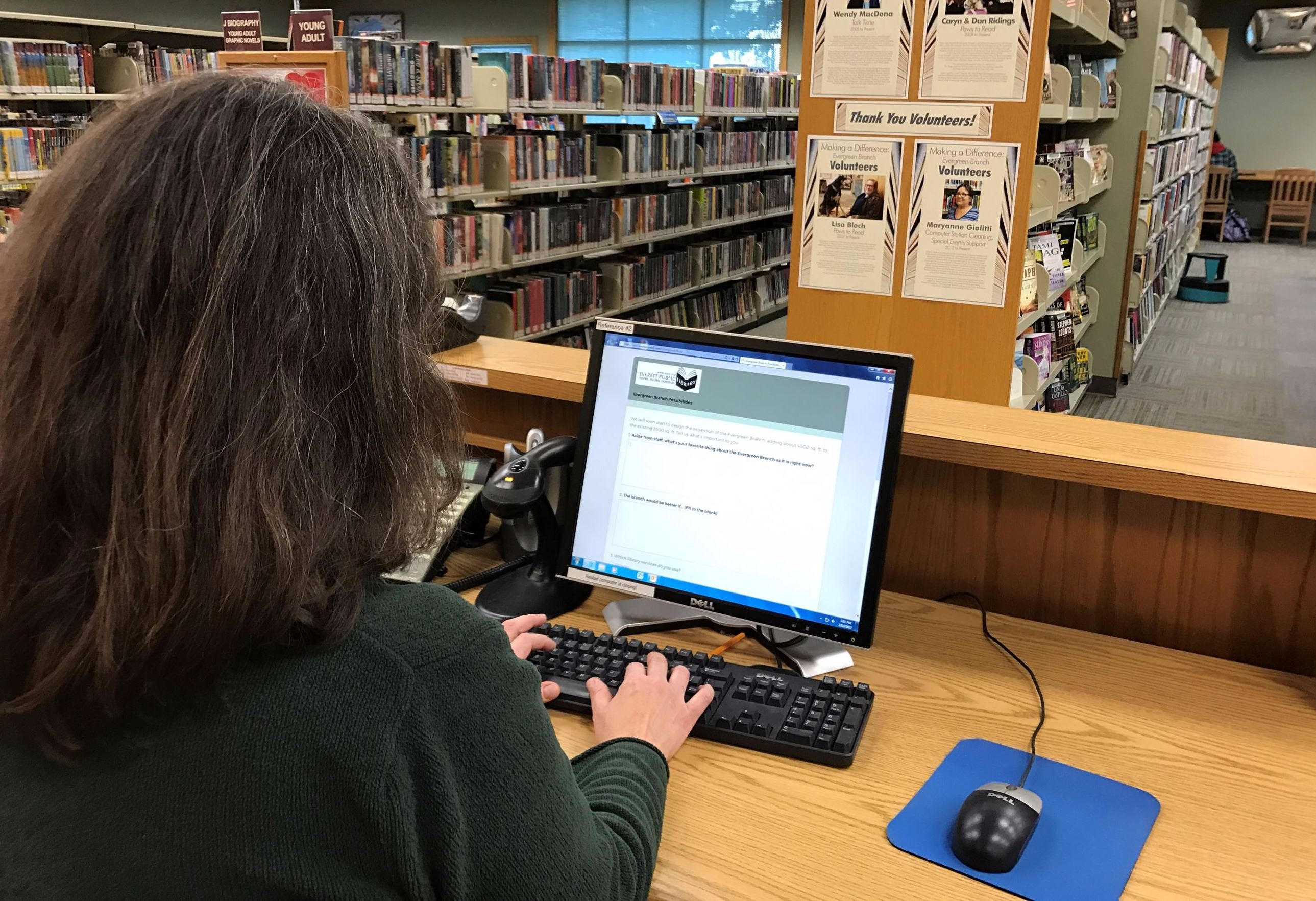 Photo of person using computer to fill out online survey at the Evergreen Branch