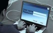 Photo of person logging in to laptop computer